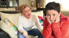 Angry mother scolding a disobedient child Stock Footage