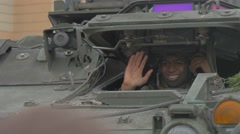 Stock Video Footage of Atlantic Resolve Operation Poland Nato Smiling Soldier is Waving His Hand in a