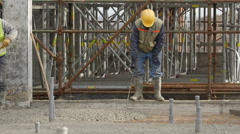 Worker preparing armature for pouring of liquid concrete. Stock Footage