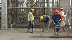 Workers preparing armature, and leveling liquid concrete. Stock Footage