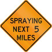 Road sign used in the US state of Virginia - Spraying next 2 miles - stock illustration