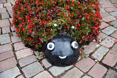 Ladybug flower bed on tha Streets of Kaunas old town - stock photo