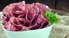 Sliced Salami (seamless loopable 4K footage) Stock Footage