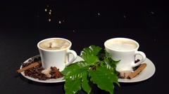 Two cups of coffee on a black background. A sugar cube falls in a cup of coffee. Stock Footage