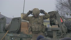 Soldiers Put an Helmets on Standing on a Roof Military Vehicle Martial Law Stock Footage