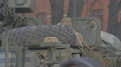 Soldier is Getting Into Military Vehicle Young Man in Camouflage in Panzer of Stock Footage