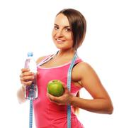 Healthy woman with water and apple diet smiling Stock Photos