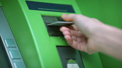 The woman`s hand inserting credit card in atm. Without human face Stock Footage