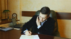 Businessman discussing document with colleague on mobile phone Stock Footage
