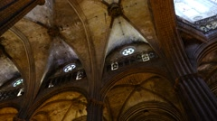 Arched ceiling at Gothic Cathedral, panning shot, round windows under roof Stock Footage