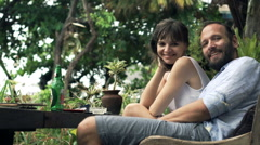 Portrait of happy couple in cafe in the garden Stock Footage