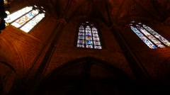 Colorful stained-glass windows at Gothic Cathedral, POV camera move inside - stock footage