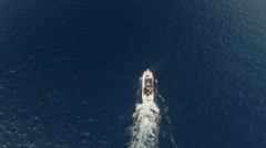 Offshore Oil Drilling Rig and Boat Aerial Stock Footage