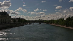 View of Paris and the river Seine with boats. On the left side the Musée d'Orsay Stock Footage