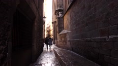 POV walk through narrow stony passageway, alley at Ciutat Vella district Stock Footage