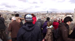 Tourists crowd at top bell tower, watch around old city panorama from height Stock Footage