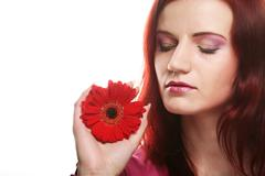 young woman with gerber flower - stock photo