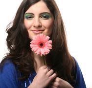 Beautiful young woman with gerber flower Stock Photos