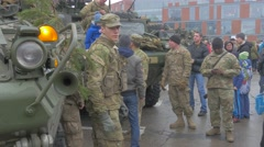 People Kids Around Military Vehicles Opole Poland Operation of Nato Mixed Race Stock Footage
