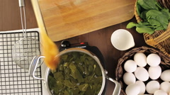 Dyeing Easter eggs with natural dye from spinach. Stock Footage
