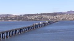 Elevated view of timelapse of trains crossing Tay Rail Bridge Dundee Scotland Stock Footage