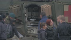 People Walk by Opened Cabin of Truck Nato Operation in Opole Soldiers and Stock Footage