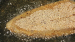 Frying Crumbed Fish Fillet - stock footage