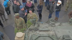 Soldiers Near Military Vehicle Nato Operation Opole People Are Walking by City Stock Footage