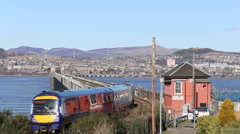 Train crossing Tay Rail Bridge Dundee Scotland 7th March 2016 Stock Footage