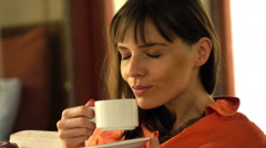 Stock Video Footage of Pretty, content woman enjoy coffee on sofa, super slow motion