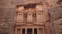 A wide tilt shot of the Treasury building in Petra Stock Footage