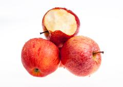 Stock Photo of one red apple biten off with isolated background