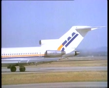 TAA & QANTAS AIRCRAFT - taking off, melbourne airport (1983) Stock Footage