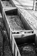 wagons loaded with coal on rails - stock photo