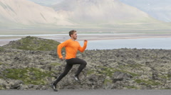 Running sport man sprinting in slow motion Stock Footage