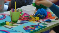 Kids Are Gluing a Colorful Threads Put Brushes Into Bowl of Glue Kids Are Stock Footage