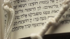 Hebrew Bible with Prayer Shawl Tallis Stock Footage