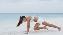 Exercising woman doing fitness exercises on beach exercise training outside Stock Footage