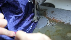 Woman sewing blue clothes using sewing machine Stock Footage