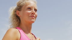 Running woman runner close up jogging outside exercising on beach - healthy life Stock Footage