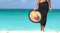 Woman In Black Bikini And Sarong Standing On Beach - Summer Vacation Concept Stock Footage