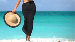 Woman In Black Sarong Holding Sunhat At Beach - Summer Vacation Concept Stock Footage