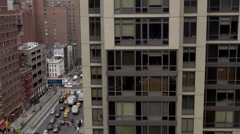 aerial view over east side of Manhattan with busy traffic in street below, NYC - stock footage