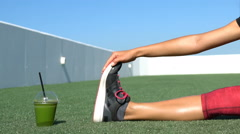 Sporty Woman Exercising By Juice Glass On Field - Fitness Exercise Close up Stock Footage