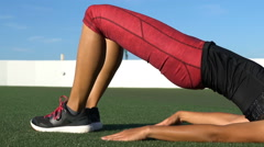 Sporty Woman Doing Spine Hip Lift Exercise - Fitness Exercise Close up Stock Footage