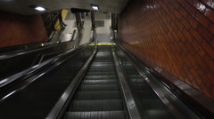 Down escalator in subway station - empty riding first person person NYC Stock Footage