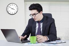 Arabian employee works overtime in office Stock Photos