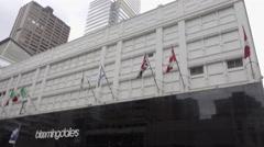 Bloomingdales department store in Midtown Manhattan, flags tilting street 4K NYC Stock Footage