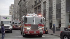 FDNY fire truck with siren rushing to emergency in slow motion NYC Stock Footage