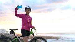 Happy Female Cyclist Taking Selfie Using Phone - Healthy Active Lifestyle Stock Footage